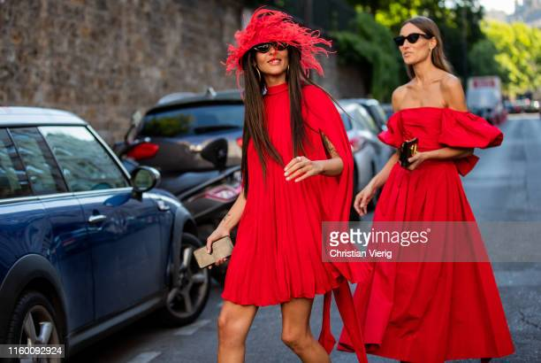 Giorgia Tordini and Gilda Ambrosio seen wearing red dress outside Valentino during Paris Fashion Week - Haute Couture Fall/Winter 2019/2020 on July...