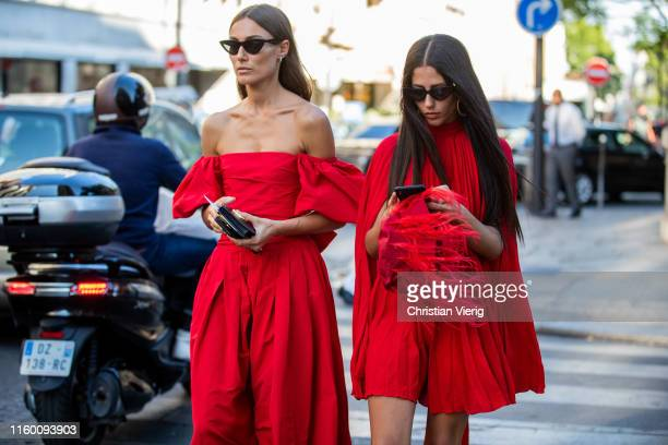Giorgia Tordini and Gilda Ambrosio seen wearing red dress outside Valentino during Paris Fashion Week Haute Couture Fall/Winter 2019/2020 on July 03...