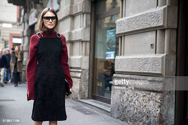 Giorgia Tordini of The Attico wears Celine sunglasses and a black suede dress over a long red sweater outside the Sportmax show during the Milan...