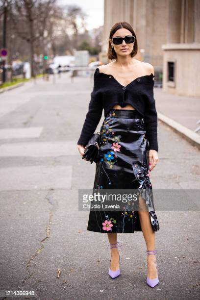 Giorgia Tordini, wearing a black cropped cardigan, black leather floral print midi skirt, lilac heels and black bag, is seen outside Miu Miu, during...
