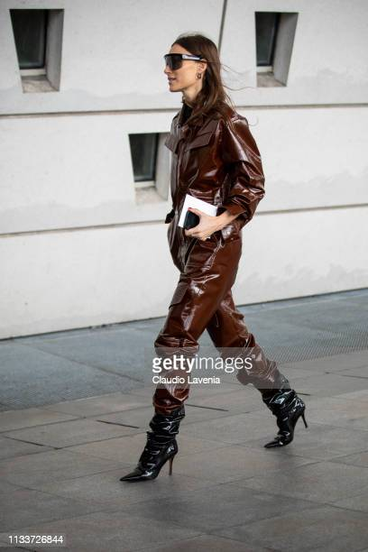 Giorgia Tordini wearing a brown leather jumpsuit black boots and black sunglasses is seen outside Giambattista Valli on Day 8 Paris Fashion Week...