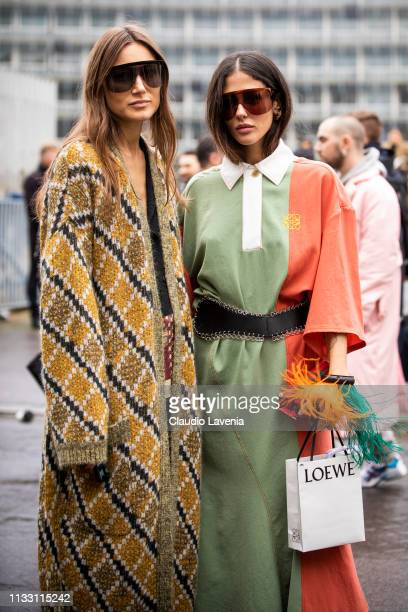 Giorgia Tordini wearing a long decorated cardigan and Gilda Ambrosio wearing a green and orange dress with black belt are seen outside Loewe on Day 5...