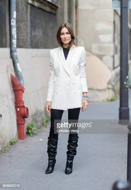 Giorgia Tordini wearing a white blazer black boots black pants outside Rodarte during Paris Fashion Week Haute Couture Fall/Winter 20172018 Day One...