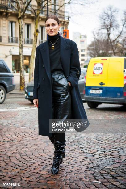 Giorgia Tordini wearing black coat and black leather pants is seen in the streets of Paris after the Nina Ricci show during Paris Fashion Week...