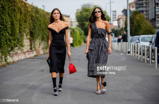 Giorgia Tordini wearing black off shoulder dress and Gilda Ambrosio wearing checkered dress, heels seen outside the Prada show during Milan Fashion...