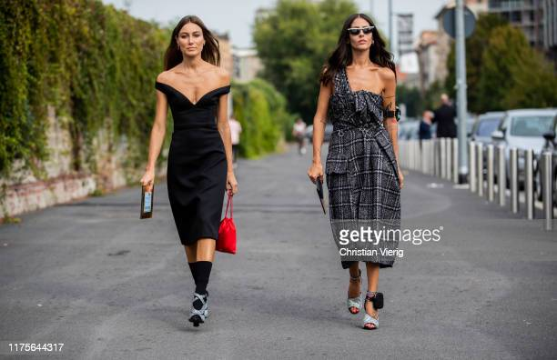 Giorgia Tordini wearing black off shoulder dress and Gilda Ambrosio wearing checkered dress heels seen outside the Prada show during Milan Fashion...