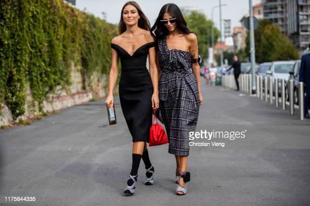 Giorgia Tordini wearing black off shoulder dress and Gilda Ambrosio wearing checkered dress heels seen outside the Prada show during Milan Fashion...