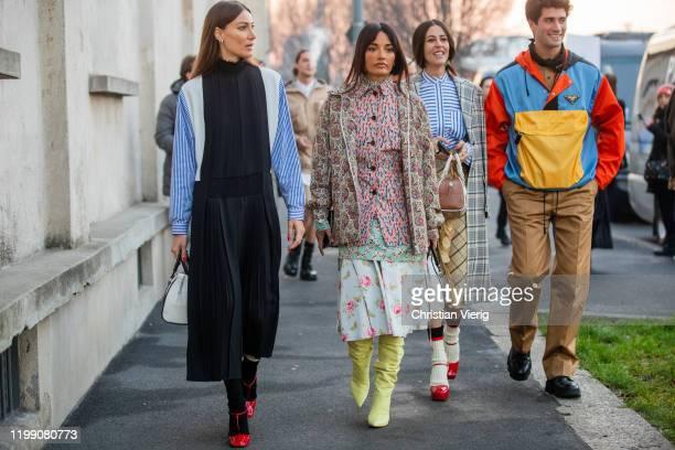 Giorgia Tordini wearing black white blue striped multi colored dress Amina Muaddi wearing mixed pattern Gilda Ambrosio wearing Prada bag yellow skirt...