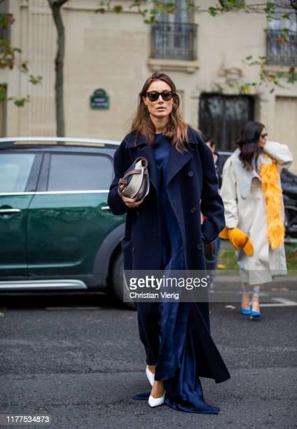 Giorgia Tordini wearing navy long coat is seen outside Loewe during Paris Fashion Week Womenswear Spring Summer 2020 on September 27, 2019 in Paris,...