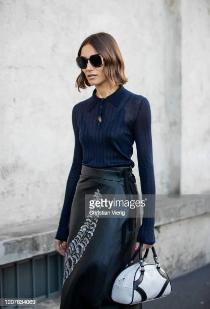 Giorgia Tordini wearing navy sheer top black high waist skirt Prada bag seen outside Prada during Milan Fashion Week Fall/Winter 20202021 on February...
