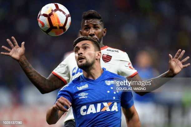 Giorgian De Arrascaeta of Brazil's Cruzeiro vies for the ball with Rodinei of Brazil's Flamengo during their 2018 Copa Libertadores match held at...