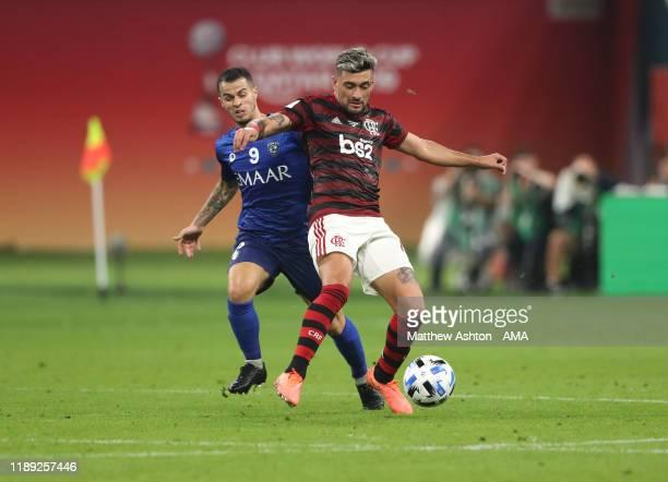 Giorgian De Arrascaeta of CR Flamengo and Sebastian Giovinco of Al Hilal during the FIFA Club World Cup Qatar 2019 Semi Final match between CR...