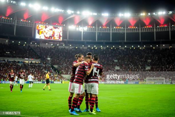 Giorgian De Arrascaeta of Flamengo celebrates with a teammates after scoring a goal during a match between Flamengo and Gremio as part of Brasileirao...