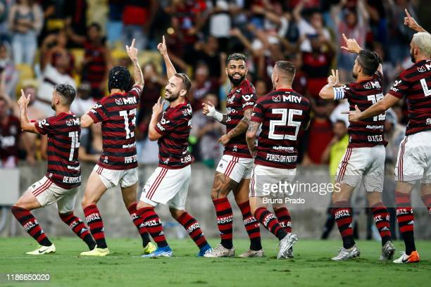 Giorgian De Arrascaeta of Flamengo celebrates with a teammates after scoring the first goal of his team during a match between Flamengo and Avai as...