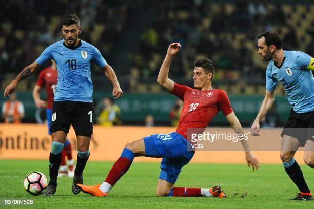 Giorgian De Arrascaeta of Uruguay and Patrik Schick of Czech Republic compete for the ball during the 2018 China Cup International Football...
