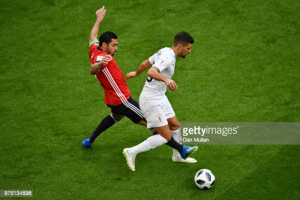 Giorgian De Arrascaeta of Uruguay challenge for the ball with Ahmed Fathi of Egypt during the 2018 FIFA World Cup Russia group A match between Egypt...