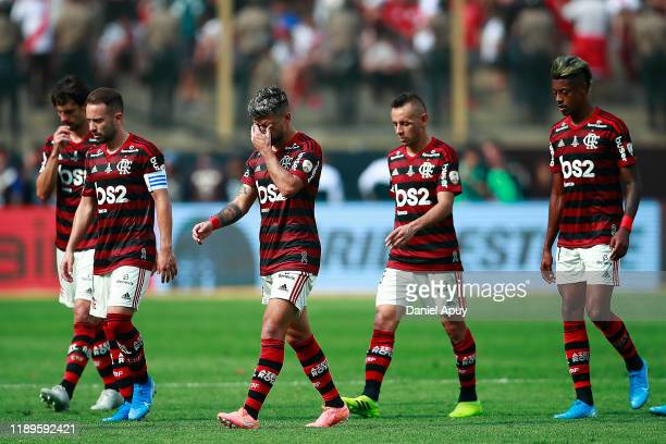 Giorgian De Arrascaeta Rafinha and Bruno Henrique of Flamengo react as they leave the pitch after the first half during the final match of Copa...