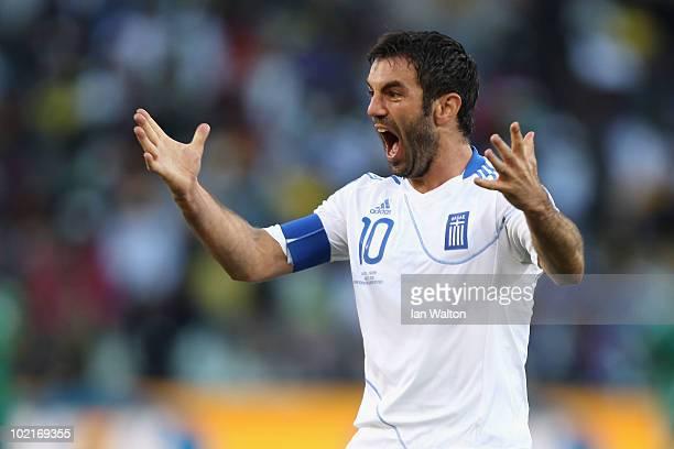 Giorgias Karagounis of Greece celebrates after Dimitrios Salpingidis scores a goal during the 2010 FIFA World Cup South Africa Group B match between...