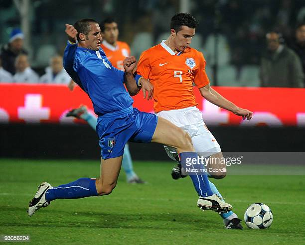 Giorgiio Chiellini of Italy tackles Robin van Persie of Holland during the international friendly match between Italy and Holland at Adriatico...