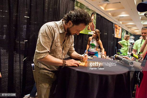 Giorgio A Tsoukalos executive producer of Ancient Aliens signs autographs for Alien Con 2016 fans and attendees on October 29 2016 in Santa Clara...