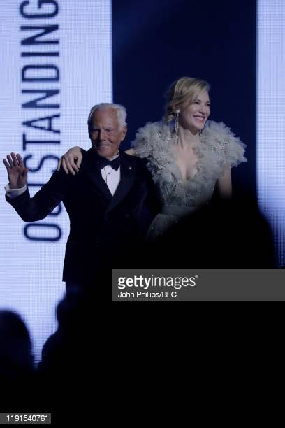 Giorgio Armani and Cate Blanchett on stage during The Fashion Awards 2019 held at Royal Albert Hall on December 02 2019 in London England