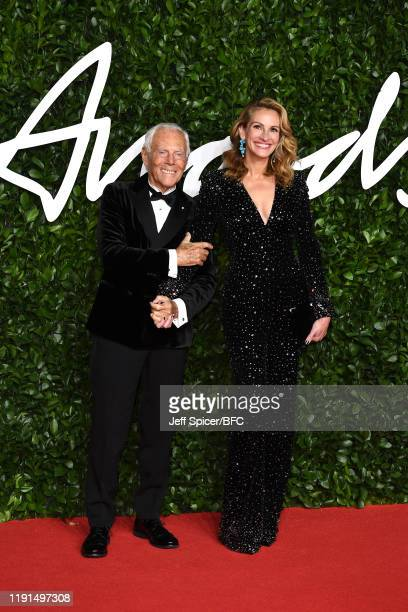 Giorgio Armani and Julia Roberts arrive at The Fashion Awards 2019 held at Royal Albert Hall on December 02, 2019 in London, England.