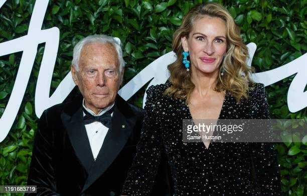 Giorgio Armani and Julia Roberts arrive at The Fashion Awards 2019 held at Royal Albert Hall on December 02 2019 in London England