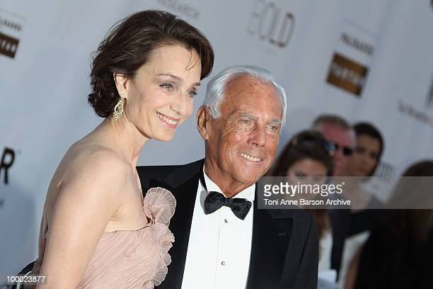 Giorgio Armani and Kristen Scott Thomas attend the amfAR Cinema Against AIDS 2010 at the Hotel du Cap during the 63rd Annual Cannes Film Festival on...