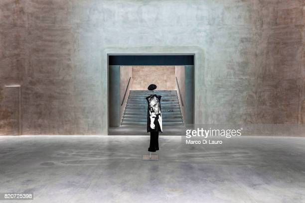 Giorgio Armani portrait depicted on a dress is seen at the entrance of the exhibition at the Armani Silos on April 30 2015 in Milan Italy In 1975...