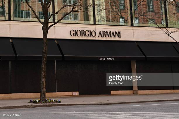 Giorgio Armani store on Madison Avenue is seen boarded up during the coronavirus pandemic on April 08 2020 in New York City COVID19 has spread to...