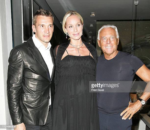 Giorgio Armani with Chelsea football player Andriy Shevchenko and his model wife Kristen Pazik