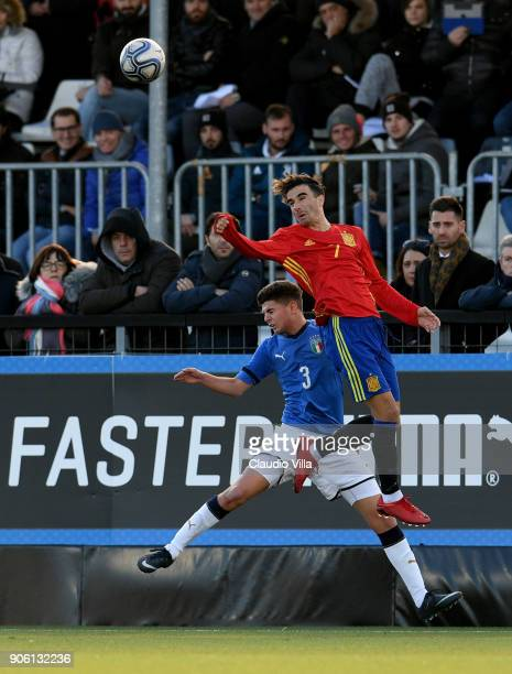 Giorgio Brogni of Italy and Roberto Gonzales of Spain compete for the ball during the U17 International Friendly match between Italy and Spain at...