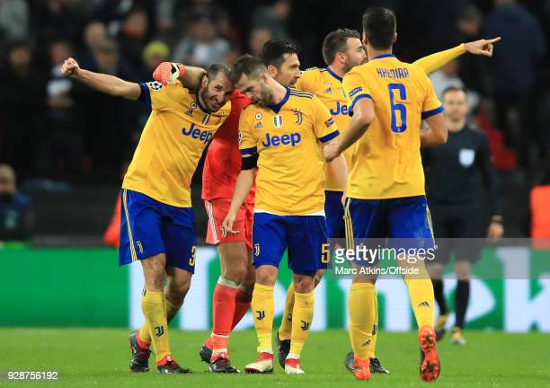 Giorgio Cheillini of Juventus and Miralem Pjanic of Juventus celebrate their victory during the UEFA Champions League Round of 16 Second Leg match...