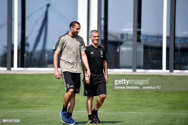 Giorgio Chiellini and Aldo Dolcetti during a Juventus training session at Juventus Training Center on July 9 2018 in Turin Italy