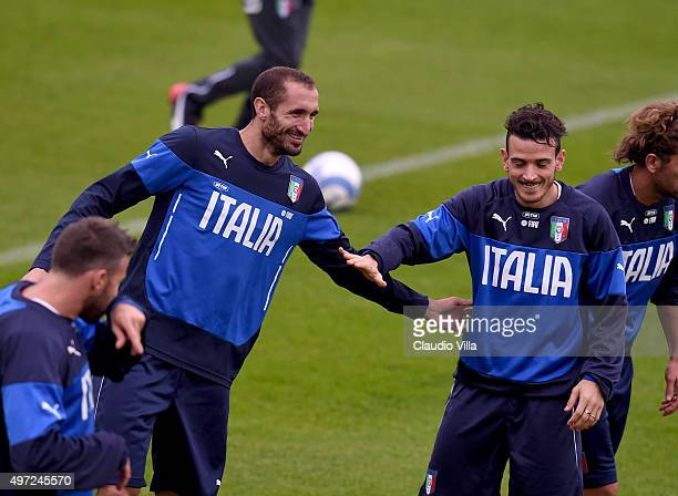 Giorgio Chiellini and Alessandro Florenzi chat during the Italy training session at Coverciano on November 15 2015 in Florence Italy