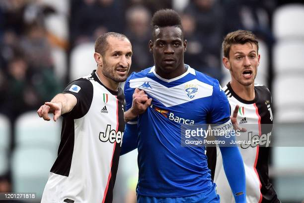 Giorgio Chiellini and Daniele Rugani of Juventus in action with Mario Balotelli of Brescia Calcio during the Serie A match between Juventus and...