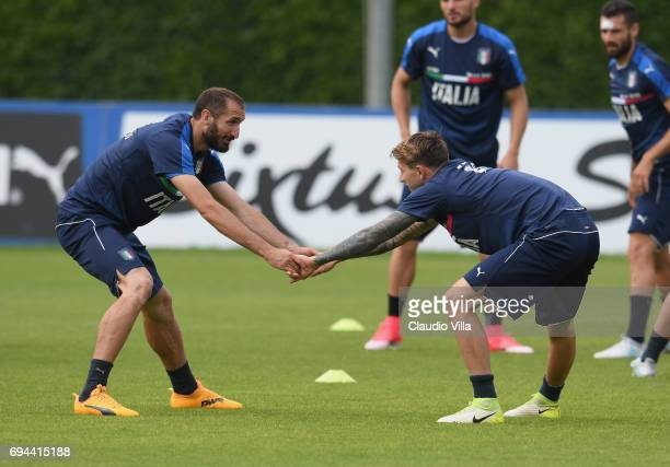 Giorgio Chiellini and Federico Bernardeschi of Italy in action during the training session at Coverciano on June 10 2017 in Florence Italy