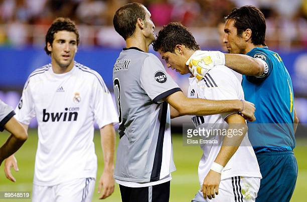 Giorgio Chiellini and Gianluigi Buffon of Juventus and Cristiano Ronaldo of Real Madrid in action during the Peace Cup match between Juventus and...