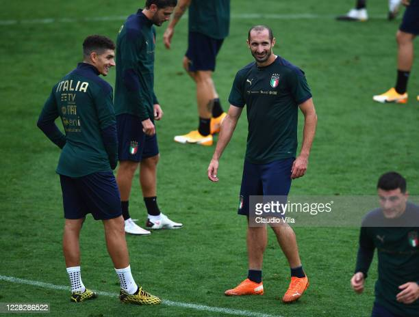Giorgio Chiellini and Giovanni Di Lorenzo of Italy react during a training session at Centro Tecnico Federale di Coverciano on August 31, 2020 in...