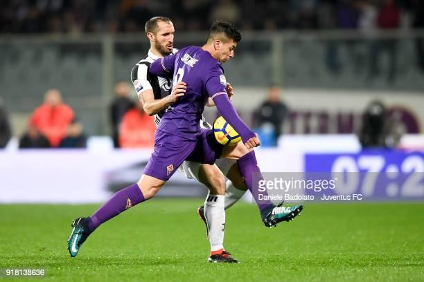 Giorgio Chiellini and Giovanni Simeone during the serie A match between ACF Fiorentina and Juventus at Stadio Artemio Franchi on February 9 2018 in...