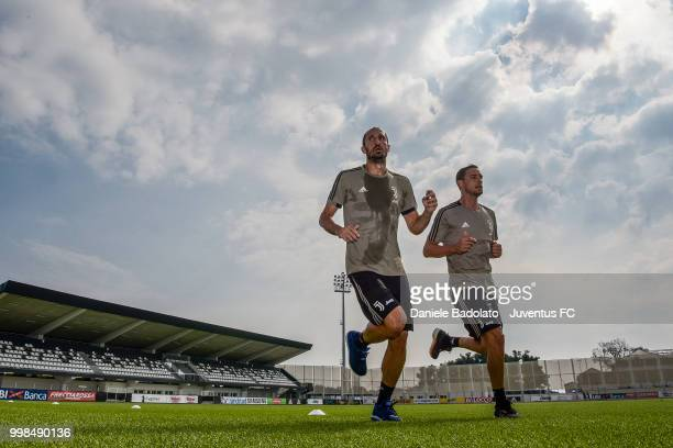 Giorgio Chiellini and Mattia De Sciglio during a Juventus morning training session on July 14 2018 in Turin Italy