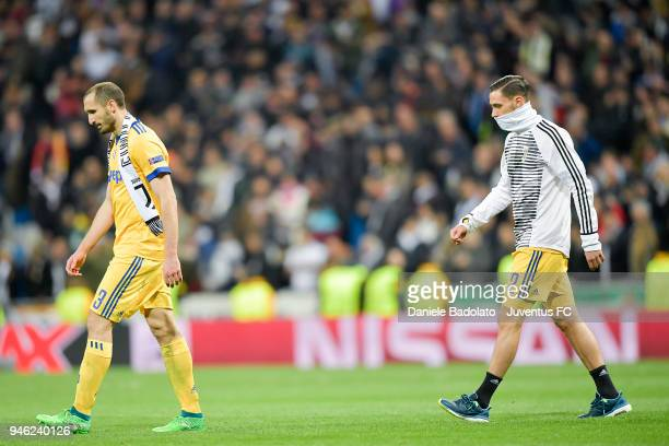 Giorgio Chiellini and Mattia De Sciglio of Juventus in action during the Champions League match between Real Madrid and Juventus at Estadio Santiago...