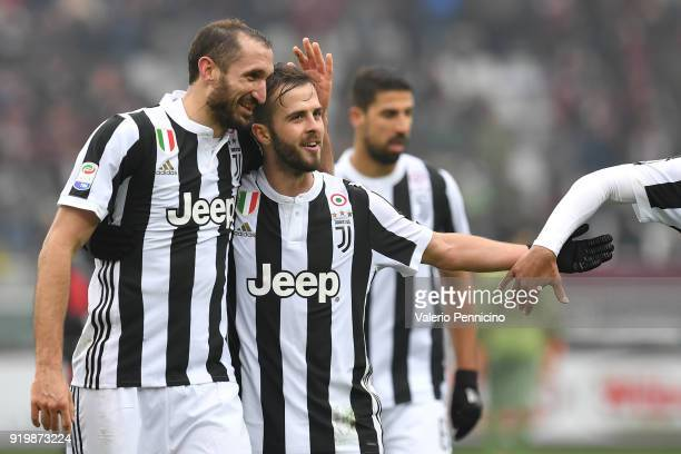 Giorgio Chiellini and Miralem Pjanic of Juventus celebrate victory at the end of the Serie A match between Torino FC and Juventus at Stadio Olimpico...