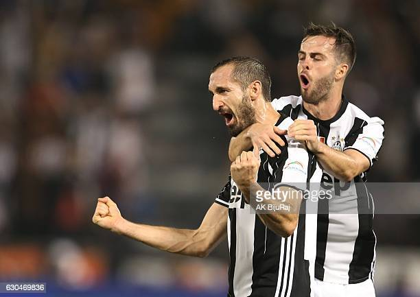 Giorgio Chiellini and Miralem Pjanic of Juventus FC celebrates scoring a goal against AC Milan during the Supercoppa TIM Doha 2016 match between...