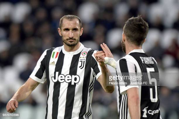 Giorgio Chiellini and Miralem Pjanic of Juventus touch fists during the serie A match between Juventus and Atalanta BC on March 14 2018 in Turin Italy