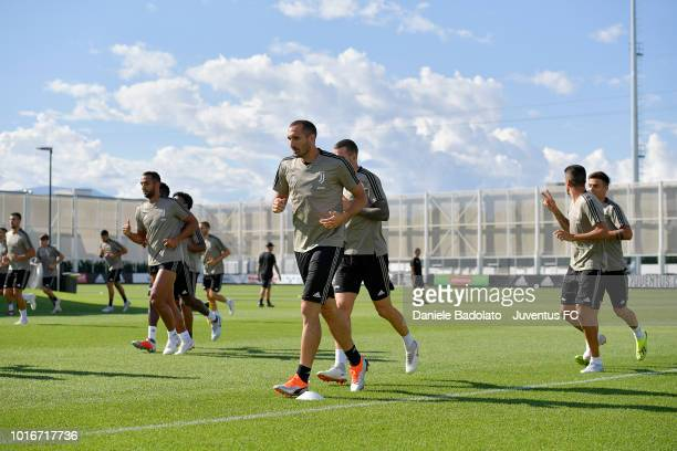 Giorgio Chiellini and teammates run during a training session at JTC on August 14 2018 in Turin Italy