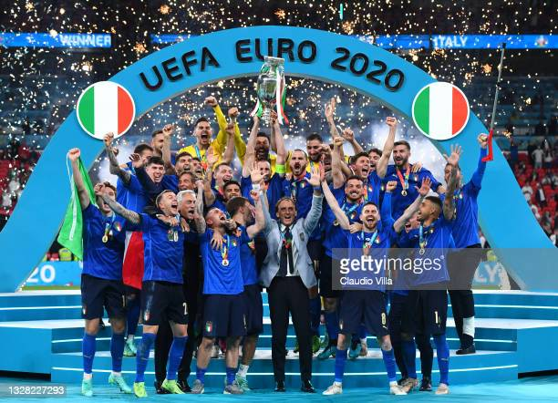 Giorgio Chiellini, Captain of Italy lifts The Henri Delaunay Trophy following his team's victory in the UEFA Euro 2020 Championship Final between...