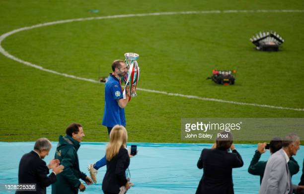 Giorgio Chiellini, Captain of Italy walks to the podium with The Henri Delaunay Trophy following his team's victory in the UEFA Euro 2020...