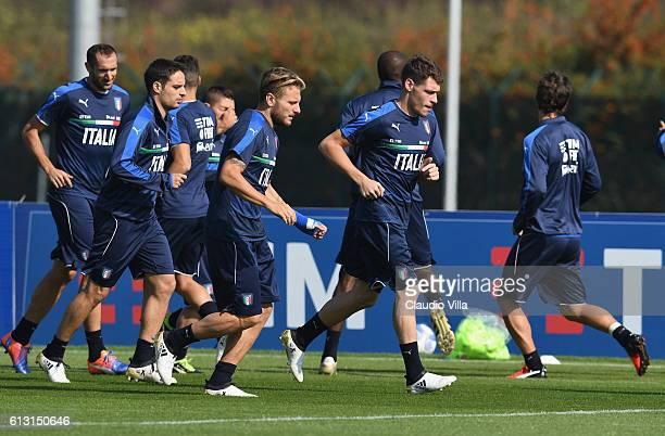 Giorgio Chiellini Giacomo Bonaventura Ciro Immobile and Andrea Belotti attend an Italy training session at Juventus Center Vinovo on October 7 2016...