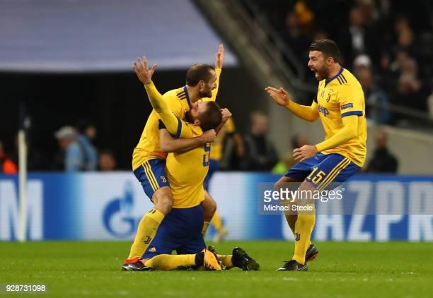 Giorgio Chiellini Gonzalo Higuain and Andrea Barzagli of Juventus celebrates as Paulo Dybala of Juventus scores their second goal during the UEFA...